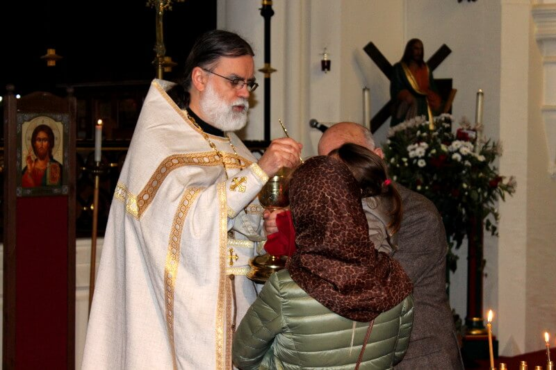 Parishioners receive communion